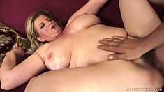 Slutty blonde chub slurps on his stick then takes it in her mature hairy bush
