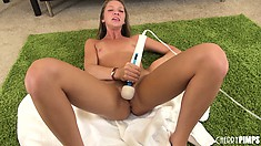 Two sex toys giving Jessie Andrews' slit the vibrations it needs