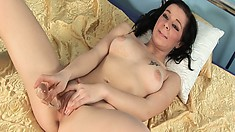 Popsie is a cute little brunette who likes her pussy filled with toys