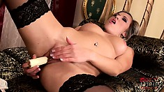 Stunning blonde with lovely tits slides a dildo in her pussy and finds pure pleasure