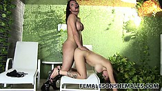 She rides on the shemale's lady cock, then gets drilled from behind