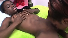 Getting that black pussy wet before ramming a big dildo into it