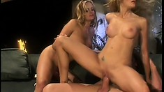 Two lucky blonde hotties sit on his snake and bounce in a threesome