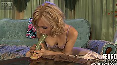 Slender blonde Betty sticks a huge dildo in her pussy and fucks it until she's pleased