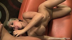 Inked up blonde whore gets a fat cock shoved in her hungry mouth