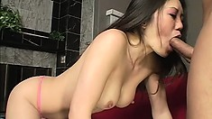 Busty Japanese girl succumbs to pleasure as a stiff cock invades her anal hole