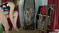 In front of the mirror, Dorothy puts her sexy slender body on display