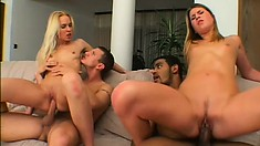 Two curvy bitches get taught how to fuck hard in a wild foursome