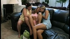 Three young babes hook up on the couch and indulge in hot lesbian sex