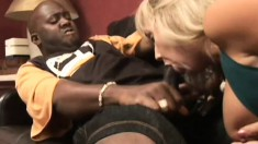 Mature white slut is chomping on a black pecker and gets a mouthful