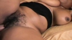 Hot ebony babe with huge natural tits feeds her passion for black cock